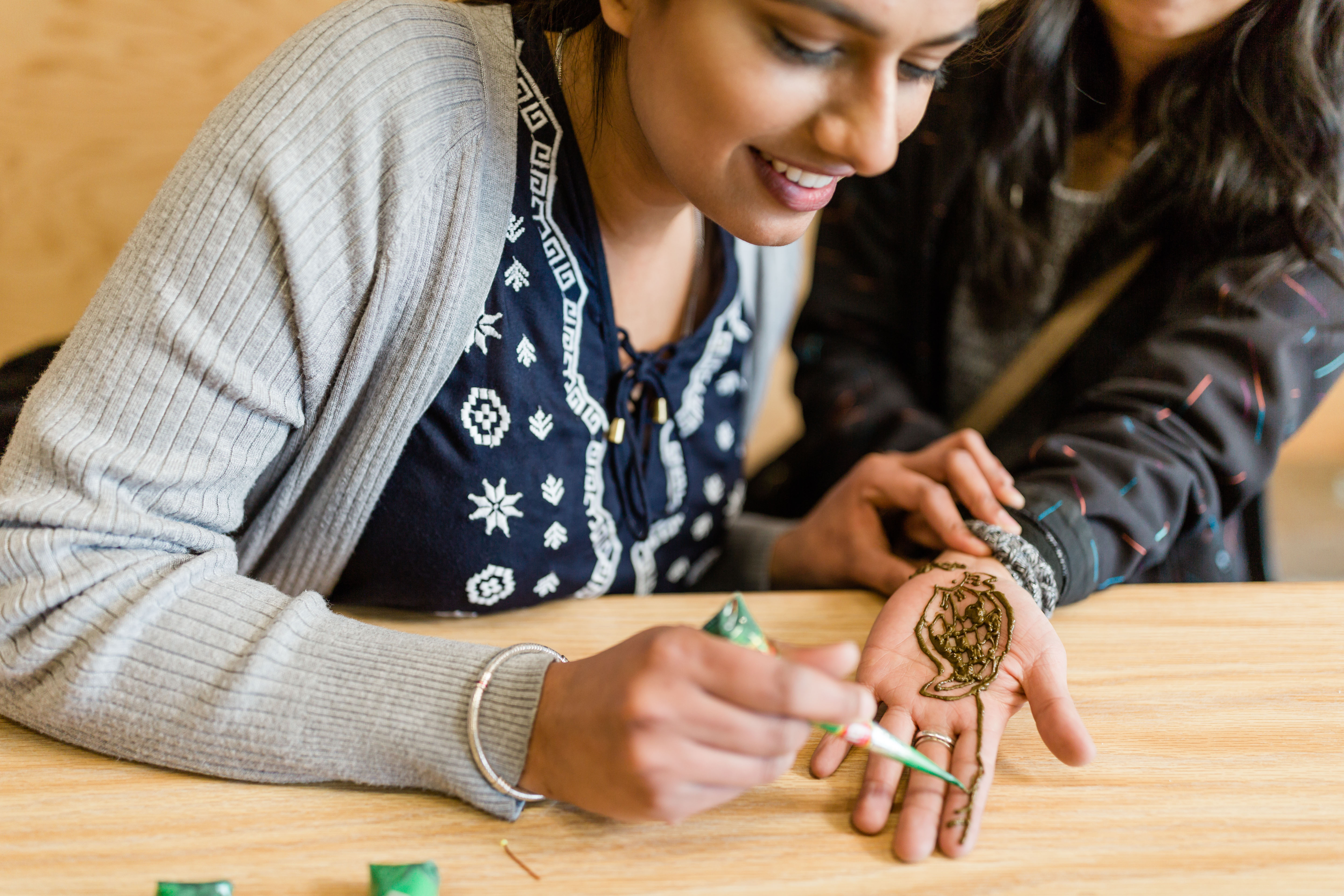 Penticton students take part in multicultural events that feature activities like henna application