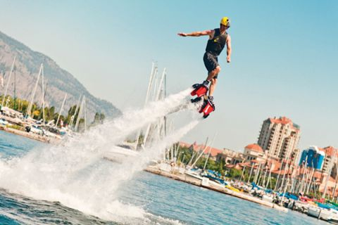 Water activities like flyboards are popular on the Kelowna lakeshore.