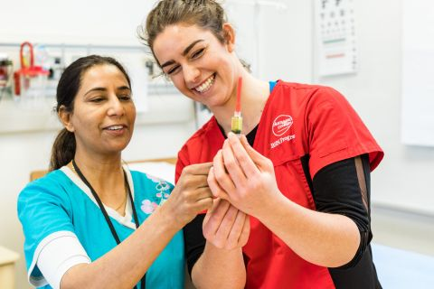 Students learn hands-on nursing skills with instructors