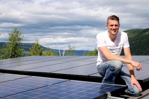 Sustainable Construction Management Technology student works on solar panels