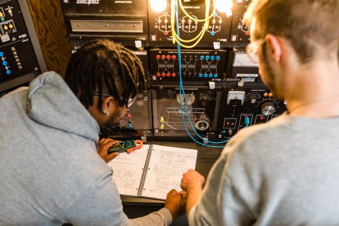 Two Electrical Pre-Apprenticeship students work on circuits