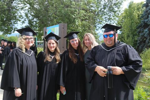 group of graduating students in caps and gowns
