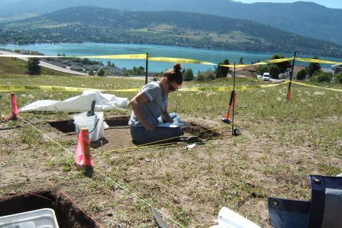 Anthropology student works on an excavation at the Vernon campus while overlooking Kal Lake