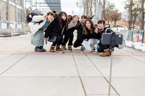 ESL study tour students pose for a group photo in downtown Kelowna