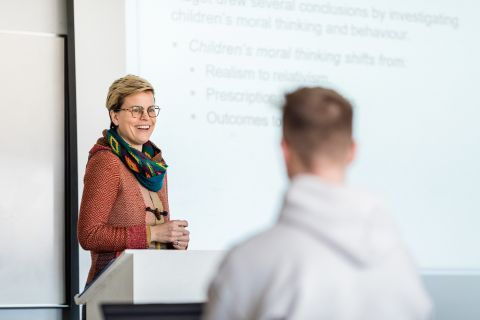 Psychology Department Professor Danielle Fullerton engages with her students during a lecture
