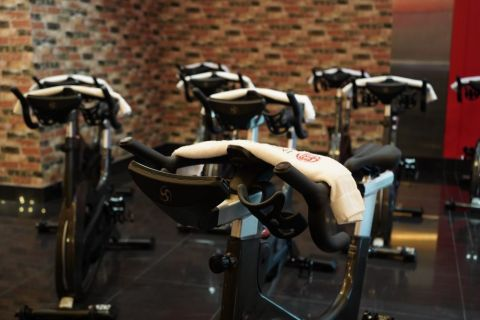 a photo of spin bikes at a spin studio.