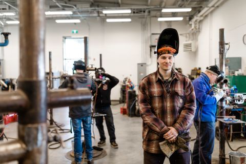 Trades student takes a break in the welding shop of the Vernon Trades Training Centre