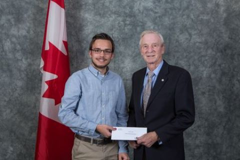 Taylor Cornett accepting the student award from Murray Roed at Okanagan College