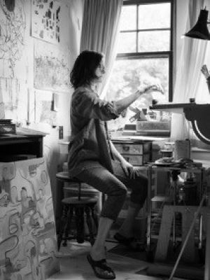 Amy Modahl paints by the light of a window in her home studio