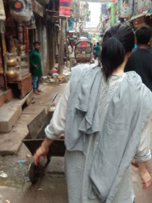 Dr. Mary Hanlon walking through the streets in Dhaka Bangladesh