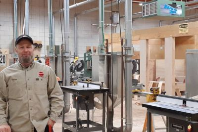 Carpentry instructor Trevor Fedderson stands in the woodworking shop