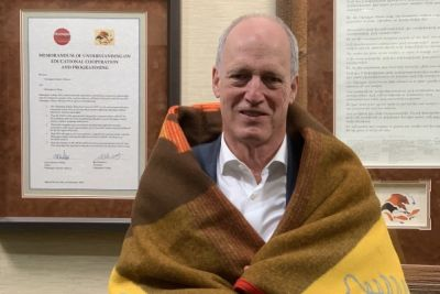 Jim Hamilton wrapped in a blanket from the Westbank First Nation