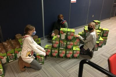 Elementary students pose socially distanced near Enactus FruitSnaps five litre juice boxes